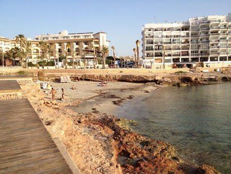 Playa Es Caló des Moro small beach in San Antoni city centre