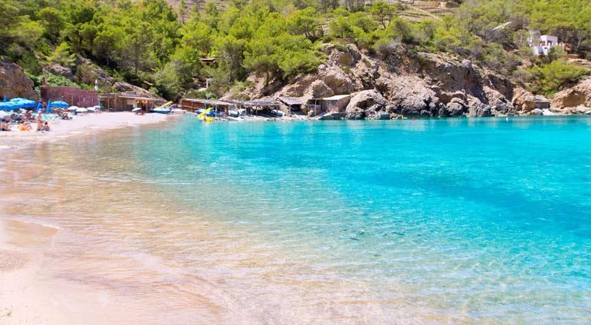 Turquoise waters in Cala-Benirras-beach-in-Ibiza