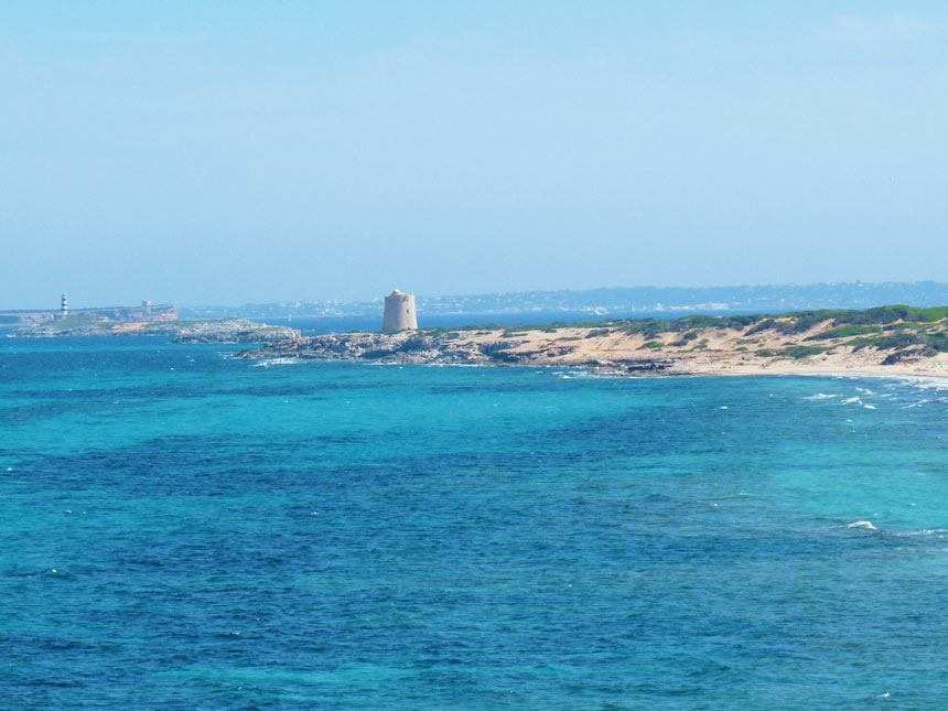 Panoramic view Ses Portes tower infront of the beach