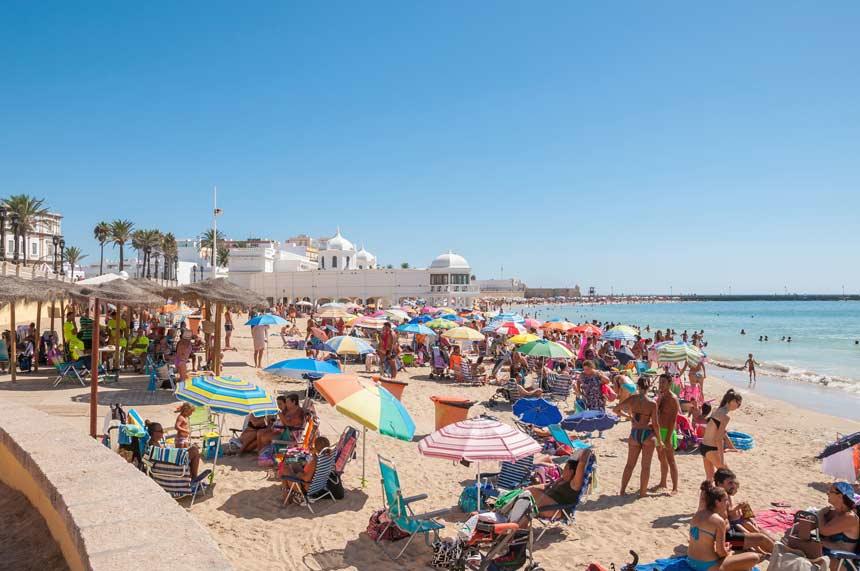 La Caleta beach full of people on summer