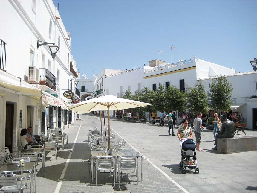 People walking around Plaza-de-España-in-Conil-de-la-Frontera