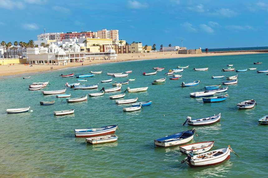 Traditional-boats-in-La-Caleta-beach-,-Cadiz