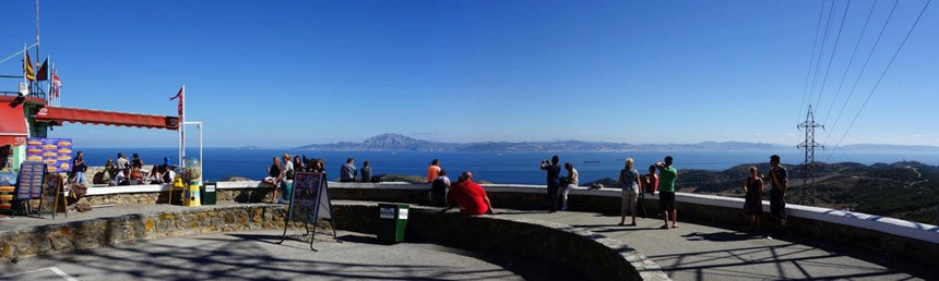 people seating on the view-point-strait-of-Gibraltar-in-Tarifa-I