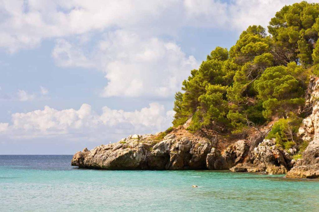Turquois waters in Cala Trebaluguer in Menorca