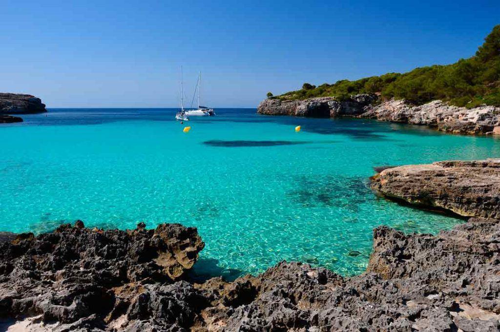 Turquois waters in Cala turqueta southern beach of Menorca