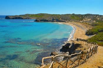 Turquois waters in Cala den Tortuga in Menorca