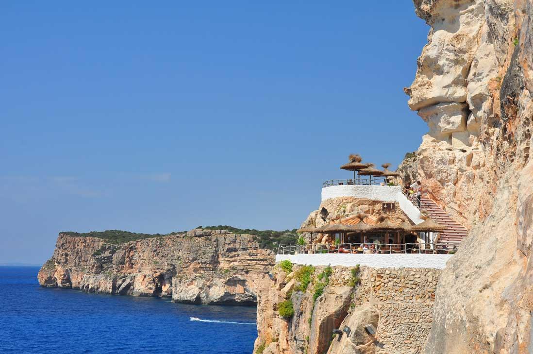 Espectacular cliffs in Cova den Xoroi infront of the Mediterranean