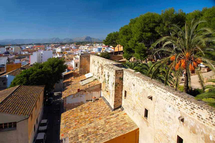 The essential tourist spots of Denia Old walls and castle in Denia overlooking the city