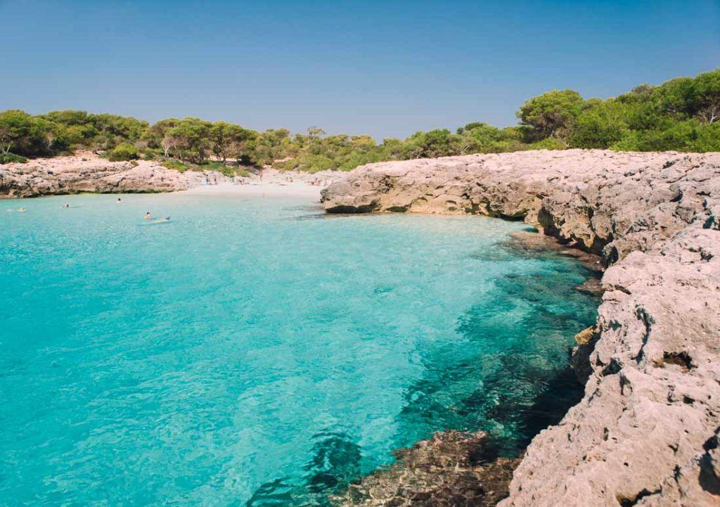 Espectacular turquois and cristaline waters of Cala Talaier in Menorca