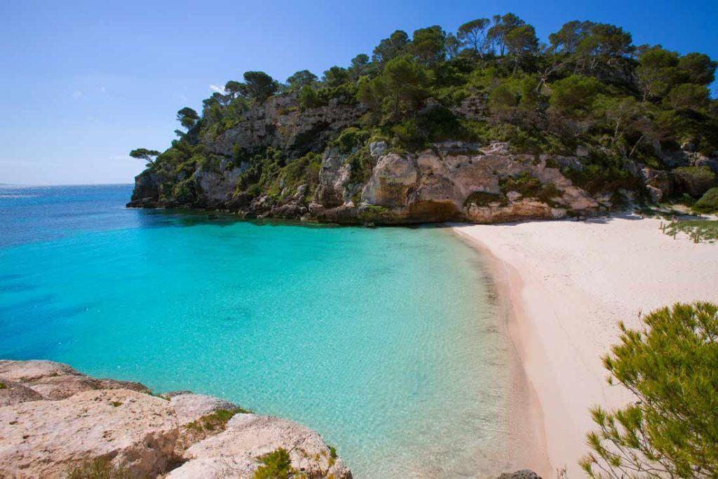 Clear turqouis water in Cala Macarelleta southern beach of Menorca