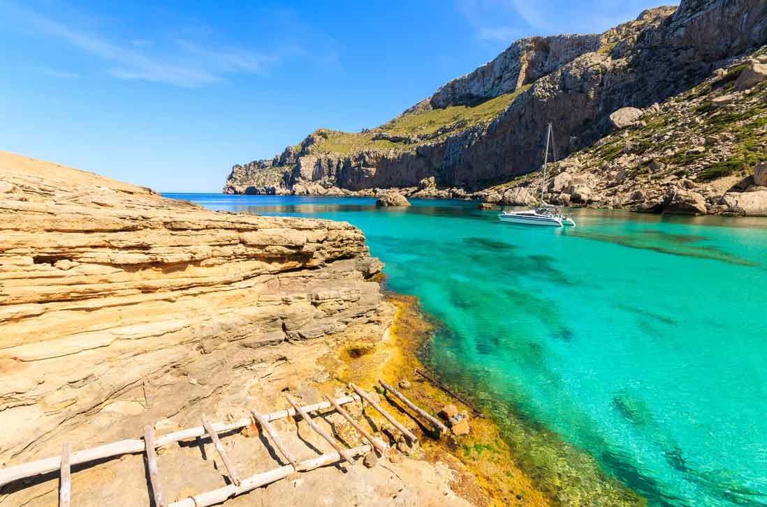 Cristaline turquois waters and beautifull landscape of Cala Figuera