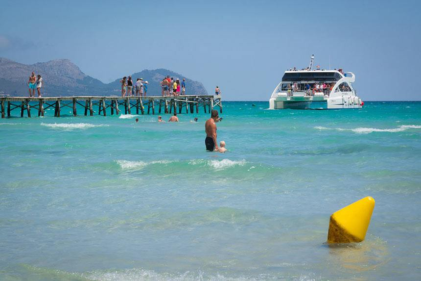 Turist Boat At Playa De Muro Beach In Alcudia