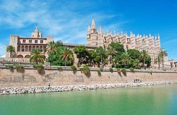 Beautifull panoramic view of Palma de Mallorca Cathedral and Almudaina Royal Palace from Parc del Mar