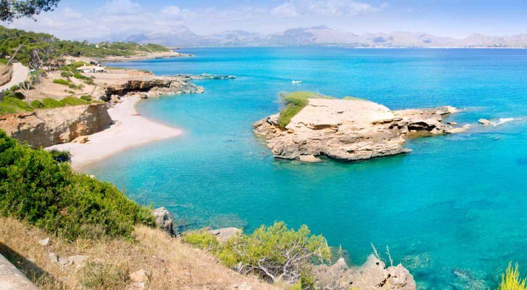 Turquois waters and small island in S'Illot
